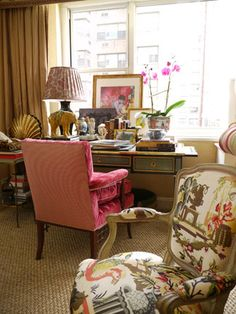 Beautiful desk, hot pink and floral chairs, nicely styled desk top, abundant windows, natural fiber rugs