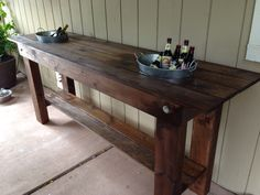 Outdoor serving table with built in ice buckets
