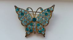 Check out this item in my Etsy shop https://www.etsy.com/listing/233136751/vintage-blue-brooch-antique-butterfly