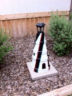 light house with clay flower pots