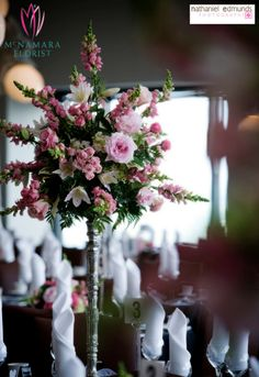 Tall pink and green floral arrangements as centerpieces at the wedding reception. Reception held at @Skyline Club Indy. Photography by @Nathaniel Edmunds Photography. Floral Designs by McNamara Florist. All Rights Reserved.