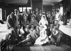 """This photo dates from about 1916 and shows WW1 soldiers recuperating at Tooting Military Hospital in London. Known as """"Wounded Blues"""" the patients were issued with blue tunics during their stay in hospital.    WWI"""