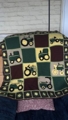Baby John Deere Afghan I made for my cousin's new grandson. This is after I put the big tractor backing on it.