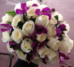 I like the purple accents! A little too much on the all white roses. A variety of white and more green would be good.