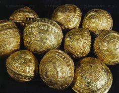 HALLSTATT CULTURE JEWELRY Gold pin-heads from a tumulus at Urtenen, Switzerland Diameter 2.5 cm Wuerttembergisches Landesmuseum, Stuttgart, Germany