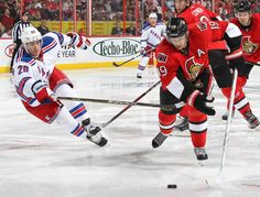 APRIL 23: Jason Spezza #19 of the Ottawa Senators stickhandles the puck away from Chris Kreider #20 of the New York Rangers in Game Six of the Eastern Conference Quarterfinals during the 2012 NHL Stanley Cup Playoffs at Scotiabank Place on April 23, 2012 in Ottawa, Ontario, Canada. (Photo by Andre Ringuette/NHLI via Getty Images)