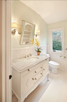 marble vanity countertop and with white carrera marble honeycomb tile floors