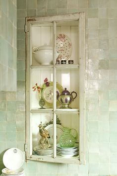 zellige tiles, old window, collection of porcelain and crystall glass. Vitrine