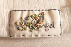 I ❤ ribbon embroidery . . . embroidered angel on blanket edge . . .