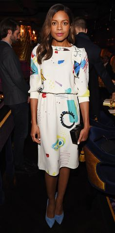 Naomie Harris got playful at the Marc Jacobs Beauty Dinner in London in an Americana-themed LWD by Marc Jacobs that she accessorized with a black box clutch and cornflower blue Chloe Gosselin pumps.