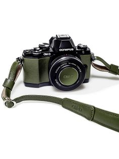 New Olympus OM-D E-M10 Limited Edition - Green with matching lens cap and leather neck strap