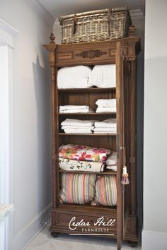 A beautiful antique armoire has been turned into a linen closet- great/beautiful storage!