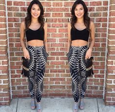 Perfect outfit for a night out!  * Racerback Crop Top  * Black & White Printed Pants  * Grey Wedges * Mini Tassel Clutch   How Could You Resist?  SHOP: aliciadimichele.com