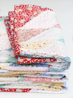 Elaine from Beech Tree Lane Handmade created this adorable baby quilt using 1930's reproduction fabrics! Her various fabrics are by Robert Kaufman Fabrics, MarcusFabrics, Penny Rose Fabrics, and Windham Fabrics. She created simple half square triangles and laid them out so that the prints made a diamond pattern. Elaine used Warm and Natural batting by The Warm Company, and quilted the quilt with #Aurifil thread.