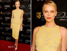 Charlize Theron In Stella McCartney -What a beautiful standout color and I love the delicate embroidery and the peplum detailing of the dress.