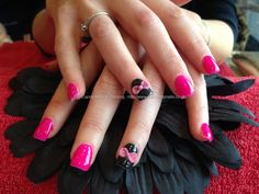 Full set of acrylic nails with ping gelux gel polish ,black gelish gel polish with 3D acrylic pink bows