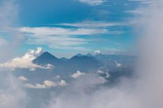 As we emerged above the cloud we finally started to see the famous vistas everyone had mentioned. Peeking through a gap in the cloud we saw the huge volcanoes that we had seen towering over Lago Atitlán a few days earlier now just distant islands in a sea of cloud.  #Guatemala #Acatenango #LagoAtitlan #volcansanpedro #volcantoliman #volcanatitlan #walk #hiking #cloud #worththewalk #volcanacatenango  #getoutside #neverstopexploring #whateveryouradventure #mountains #volcano #sky #blue…