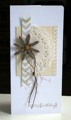 delightful tall card with an artful arrangement of stuff...doily, chevron band, flower, linen thread, die cut...