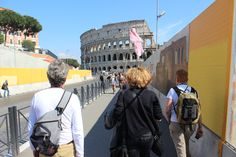 A tour guide with no tourists following behind her walks in the direction of the #Colosseum