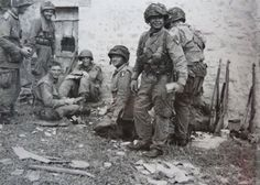Members of the 101st Airborne Division at 'La Gouderie' in Angoville-au-Plain. This historic Manor house became the Regimental Headquarters of Colonel Sink during the D-Day landings. The hamlet of Angoville-au-Plain, near Carentan, played a significant role in the D.Day landings. The Church became a field hospital for both U.S. Airborne and German casualties during D-Day and the days following.