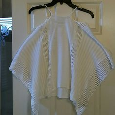 TODAY ONLY PRICE DROP! BUY IT NOW $ 30 Free People Ivory color top  drapes  off the shoulder with thin straps and the  sleeves are really pretty. This would look great with leggings or jeans.. Size XS but can fit up to a size Medium Free People Tops