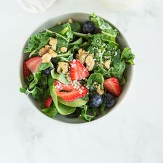 A Swiss Chard Salad recipe. A gluten free and vegetarian-friendly summer salad with berries and nuts tossed in an easy goat cheese dressing.