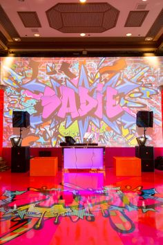 Partyslate.com Graffiti Party - This overall shot shows off the awesome graffiti art on the dance floor and backdrop at Sadie's Bat Mitzvah.