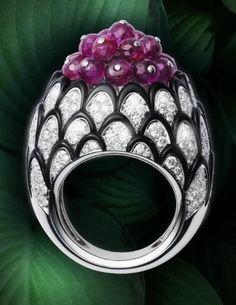 Cartier Ring, platinum, rubies, onyx, brilliant-cut diamonds.