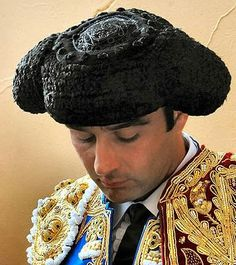 Montera. Traditional pointed cap worn by men in Galicia in northwest Spain. A classic bullfighter hat.