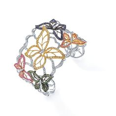 BEST BRACELET DESIGN  Over $10,000  Butterfly cuff with 1.26 cts. t.w. diamonds and 3.90 cts. t.w. rubies, sapphires, and tsavorite garnets in 18k yellow gold, pink gold, and black rhodium; $16,220; JYE Luxury  i THINK WE ALL SHOULD GET ONE INSTEAD OF THE EXPECTED RUBBER/PLASTIC ONE.  What do you think?