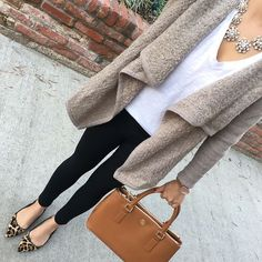 Beige cardigan + white t-shirt + statement necklace + leopard pumps