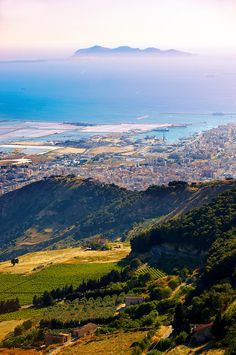 View of Trapani and its salt pans with Favignana Island in the distance from Érice, Erice, Sicily stock photos. #trapani