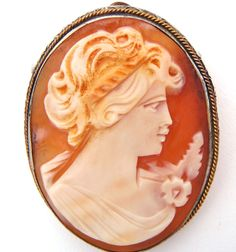 Vintage Shell Pin - This is a 1940's hand carved shell cameo pendant/brooch. It can be worn on as a pendant on a necklace or a pin. This cameo slightly concave and the silver frame was hand made to fi