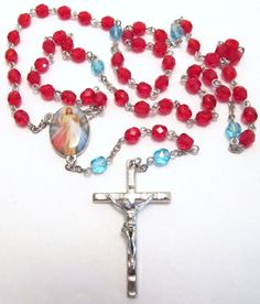 Divine Mercy Chaplet Rosary in Red and Blue by DelicateDecades, $22.50  (I need to dedicate time to Our Lord's Sacred Heart; especially so on First Friday's.)