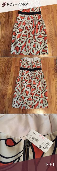 The Limited strapless dress NWT...Super cute strapless dress, burnt orange with chain print.  Great alone or with a blazer or cardigan over it.  Price listed on tag is listed $89.90, I paid $45 and never ended up wearing it. The Limited Dresses Strapless