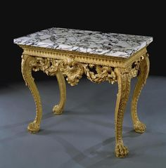 A rare and important pair of early 18th century carved giltwood side tables in the manner of William Kent. Description from artfinding.com. I searched for this on bing.com/images