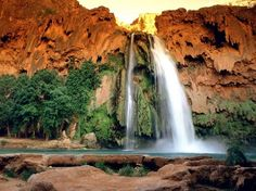 Havasu Falls - Arizona       On the Havasupai Indian Reservation within Grand Canyon National Park in Arizona you will find the gorgeous Havasu Falls. The picture perfect falls features a blue-green pool below which is excellent for swimming. Havasu Falls is fairly difficult to reach by foot, requiring a drive to Hualapai Hilltop and then a 16 km (10 mile) hike to the Falls via the tiny village of Supai which is 3 km (2 miles) from the falls. For those not up to the long hike, a helicopter ride