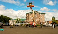Using a basket lift to build a 44' dome frame at the Oregon Green Expo in Medford, OR.