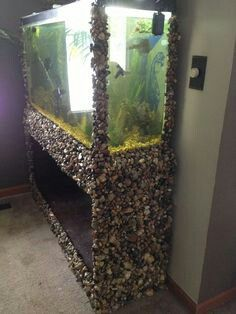 Shell covered aquarium frame and stand.