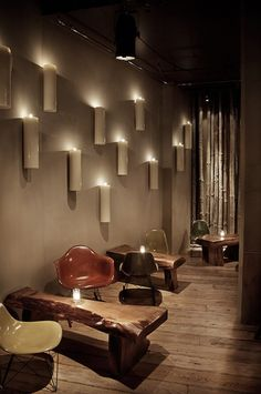 This is a hotel bar in Iceland. The candle sconce wall might look awesome on one of our decks. I love the furniture. And I want to go to Iceland.