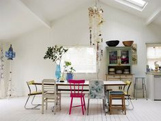 Spring pretties. love the bright open space with the mismatched furniture