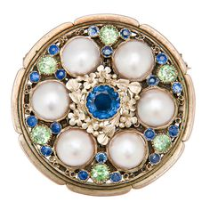 Wonderful Art Nouveau brooch, 14K Yellow Gold and set with Pearls, Demantoid Garnets, and Sapphires. The pearls have not been tested as for Natural and the smaller Sapphires appear to be Montana in Origin. This Piece is very similar to the Marcus & Co. pieces of the Time period. Circa 101-