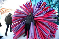 Asron Hendershott of Raw Design Inc. designers cozies up in one of their three unique and colourful warming huts that will be available for the public to try out along the River Trail soon during the annual Warming Huts: An Art and Architecture Competition on Ice at the Forks.