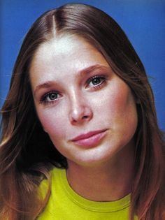what we considered ideal beauty in the 70s was totally different from the ideal of today.  Actress/model Deborah Raffin embodies the iconic 70's beauty - straight 'summer blonde' hair with a middle part, minimal makeup, and natural brows.