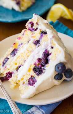 Sunshine-sweet lemon layer cake dotted with juicy blueberries and topped with lush cream cheese frosting. Take a bite and taste the bursts of bright flavors!