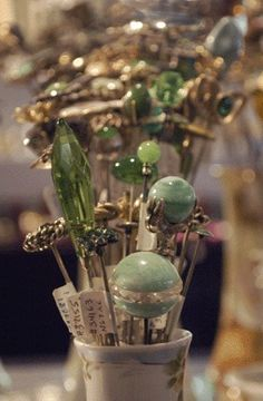 Hat pin collection with green gems and accents, what's not to love.