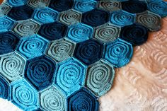 Crochet Rose Blanket pattern with step-by-step tutorial for beginner crocheters. Follow instructions to make a rose blanket. Baby, newborn, adult size