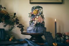 Three tier slate grey wedding cake from a nature and autumn inspired editorial for the free spirited and creative bride. Calligraphy by Moon & Tide. Captured by Bickerstaff Photograpy.