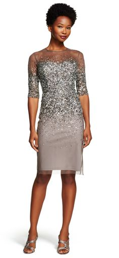A gathering of glistening sequins adorn the bodice and sleeves of this chic sheath dress with an A-line skirt.