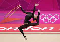 Ukraine's Alina Maksymenko competes using the hoop in her individual all-around gymnastics qualification match at the Wembley Arena during the London 2012 Olympic Games August 9, 2012.